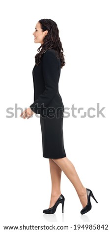 Full body of going young happy smiling business woman, isolated over white background