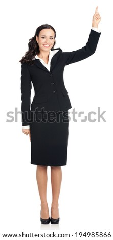 Full body of happy smiling young beautiful business woman showing up on something or copyspase for product or sign text, isolated over white background - stock photo