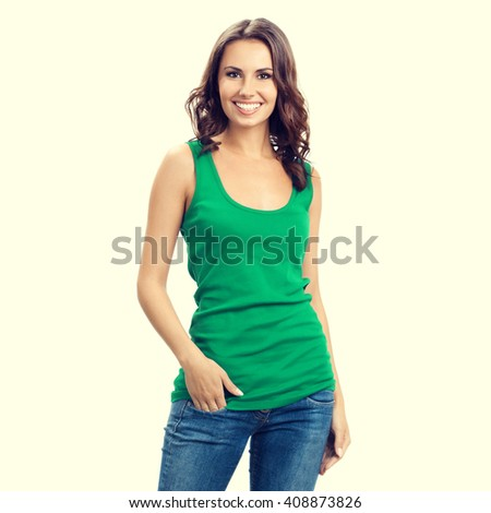 Full body of happy smiling young woman in smart green casual clothing