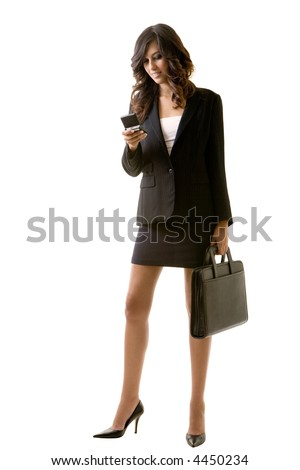 Full body of tall young brunette woman in professional business suit standing on white holding a briefcase and a cell phone - stock photo