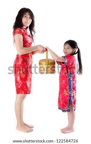 Full body oriental family in chinese red cheongsam dress, celebrating Chinese new year, isolated on white background - stock photo