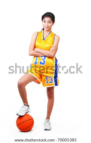 full body picture of a beautiful basketball player standing over a ball.white background - stock photo
