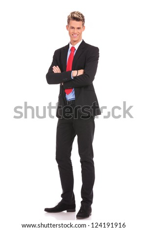 full body picture of a business man with arms crossed on white background - stock photo