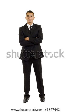 full body picture of a business man with crossed hands standing against isolated white background - stock photo