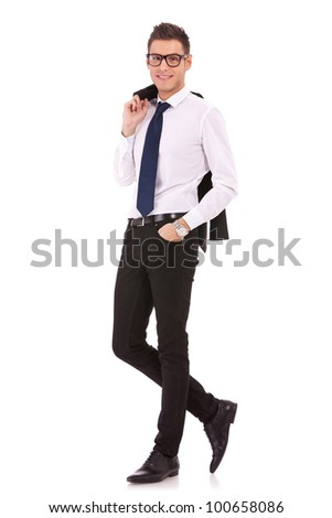 full body picture of a happy young bussiness man with coat on shoulder isolated on white background - stock photo