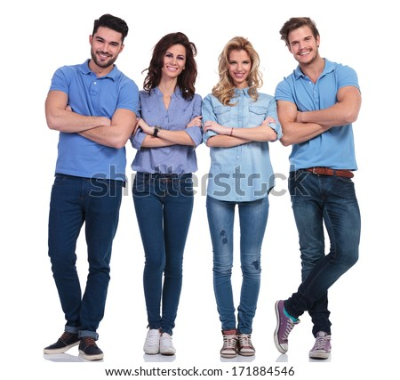 full body picture of four casual young people with hands folded standing on white background and smile - stock photo