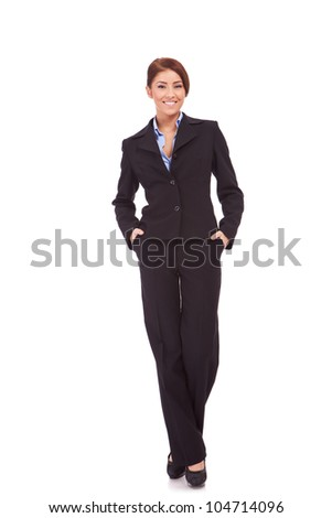full body portrait of a businesswoman with hands in pockets standing against white background - stock photo