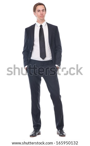 Full body portrait of a casual businessman wearing black suit - stock photo