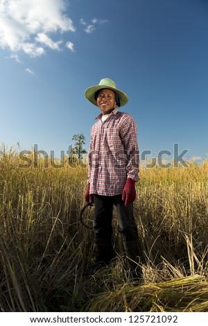 full body portrait of a thai rice farmer - stock photo