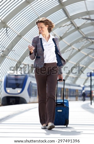 Full body portrait of a traveling business at train station - stock photo
