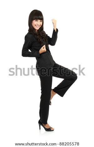 Full body portrait of excited happy asian business woman isolated on white background. - stock photo
