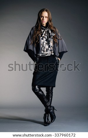 Full body Portrait of fashion model in fashion dress posing in the studio - stock photo