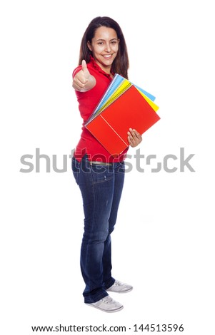 Full body portrait of female student giving thumbs up, isolated on white