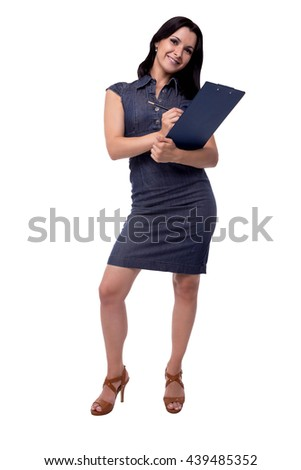 Full body portrait of happy business woman in dress writes with clipboard and pen, isolated on white - stock photo