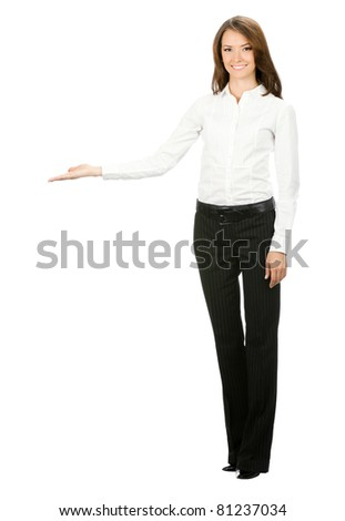 Full body portrait of happy smiling beautiful young cheerful business woma showing something, isolated on white background - stock photo