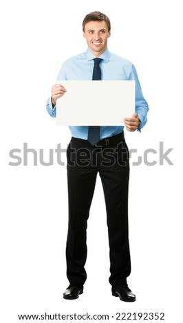 Full body portrait of happy smiling young business man showing blank signboard, isolated over white background - stock photo
