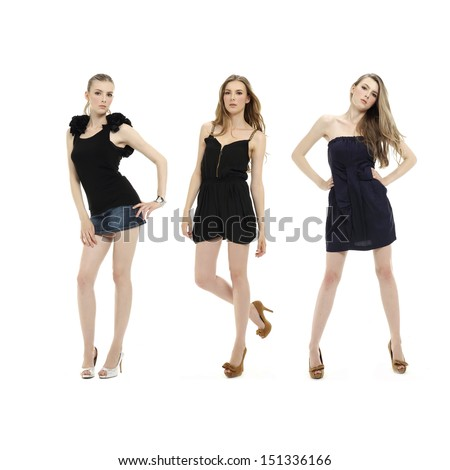 Full body Portrait of three young woman posing in little black dress