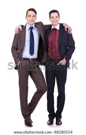 full body portrait of two friendly business men on white background