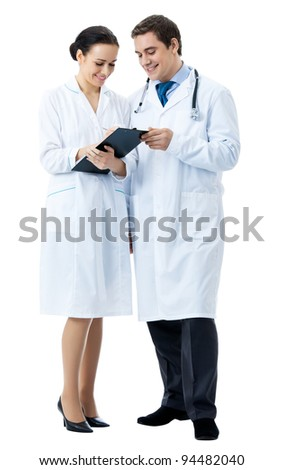 Full body portrait of two happy smiling young medical people with clipboard, isolated over white background - stock photo