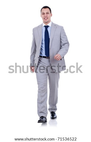 Full body portrait of walking businessman, isolated on white background