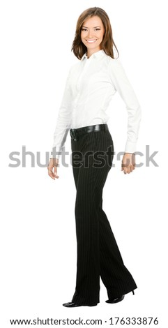 Full body portrait of walking businesswoman, isolated on white background - stock photo
