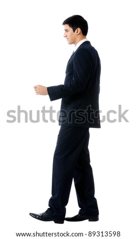 Full body portrait of walking young business man, isolated on white background