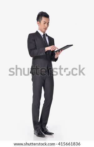 Full body Portrait of young businessman Using Digital Tablet Isolated    - stock photo