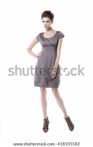 Full body portrait of Young Woman in sundress Standing posing - stock photo