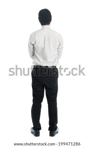 Full body rear view of Asian young male in casual business attire, standing isolated on white background. - stock photo