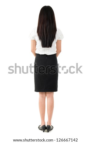 Full body rear view of beautiful Asian young girl with long black hair standing on white background - stock photo