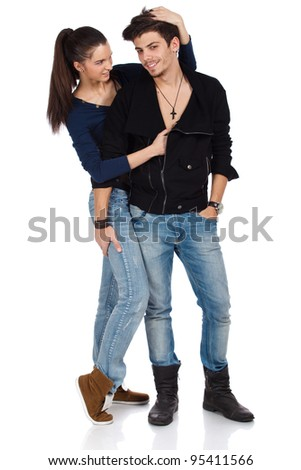 Full body shot of a happy young couple of handsome man and beautiful woman flirting and touching each other. Isolated on white background. High resolution studio image - stock photo