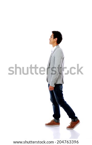 Full body side view of a fashion man walking forward - stock photo