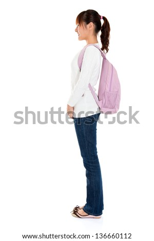 Full body side view of Asian female young adult student standing isolated on white background - stock photo