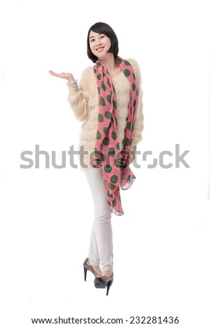 Full body smile by beautiful woman in warm clothes posing in studio - stock photo