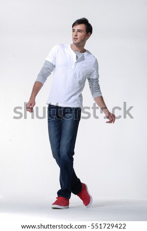 Full body Studio picture of a young and handsome man in jeans posing