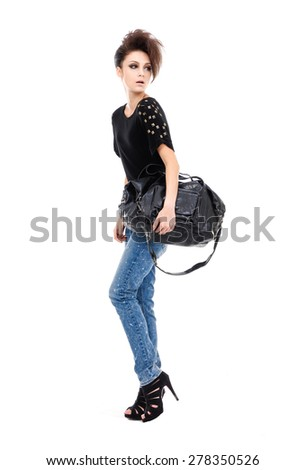 Full body Studio shot of a young woman in jeans posing - stock photo