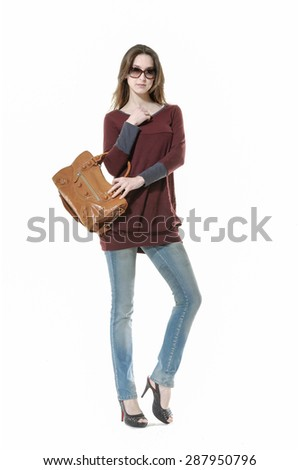 Full body Studio shot of a young woman in jeans with bag  posing - stock photo
