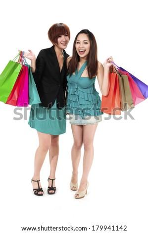 full body two beautiful asian women carrying shopping bags - stock photo
