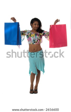 Full body view of a Beautiful young African American girl Holding colorful shopping bags - stock photo