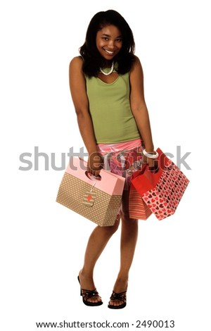 Full body view of a Happy African American girl out shopping for Valentine's Day gifts. Carrying Valentine's Day themed shopping bags