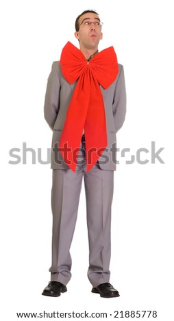 Full body view of a man wearing a Christmas bow, isolated against a white background