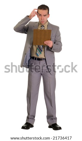 Full body view of an employee scratching his head and looking confused - stock photo