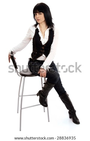 Full body view of attractive young woman sitting on a high stool. Isolated on white.