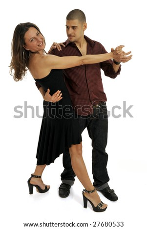 Full body view of couple in dance position, young attractive man and woman in chic wear dancing together. Isolated on white background.