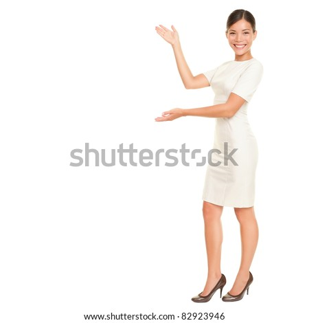 Full body woman showing and presenting copy space in business dress suit isolated on white background. Beautiful young mixed race chinese asian / white caucasian female businesswoman.