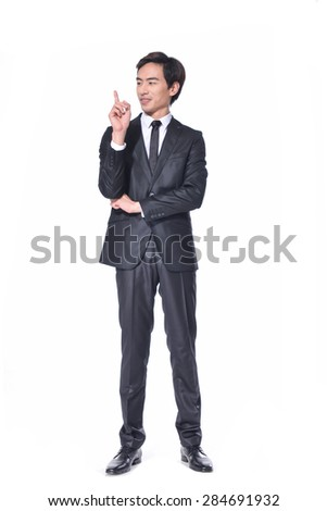 Full body young business man in a suit pointing with his fingers posing