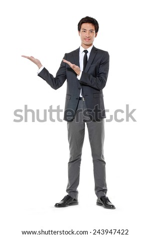 Full body young business man with arm out in a welcoming gesture  - stock photo