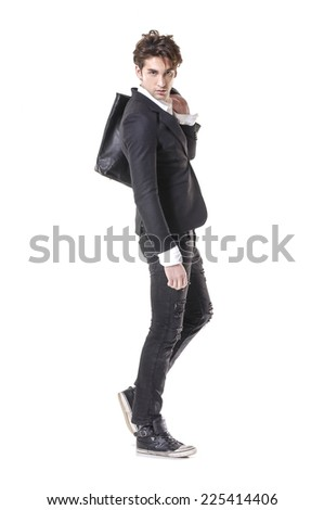 Full body young businessman standing with his bag  - stock photo