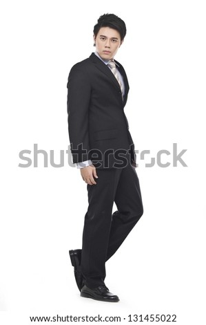 Full body young businessman walking - stock photo