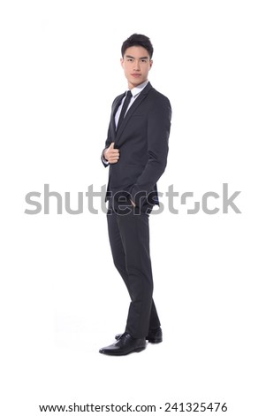 Full body young businessman walking in studio - stock photo